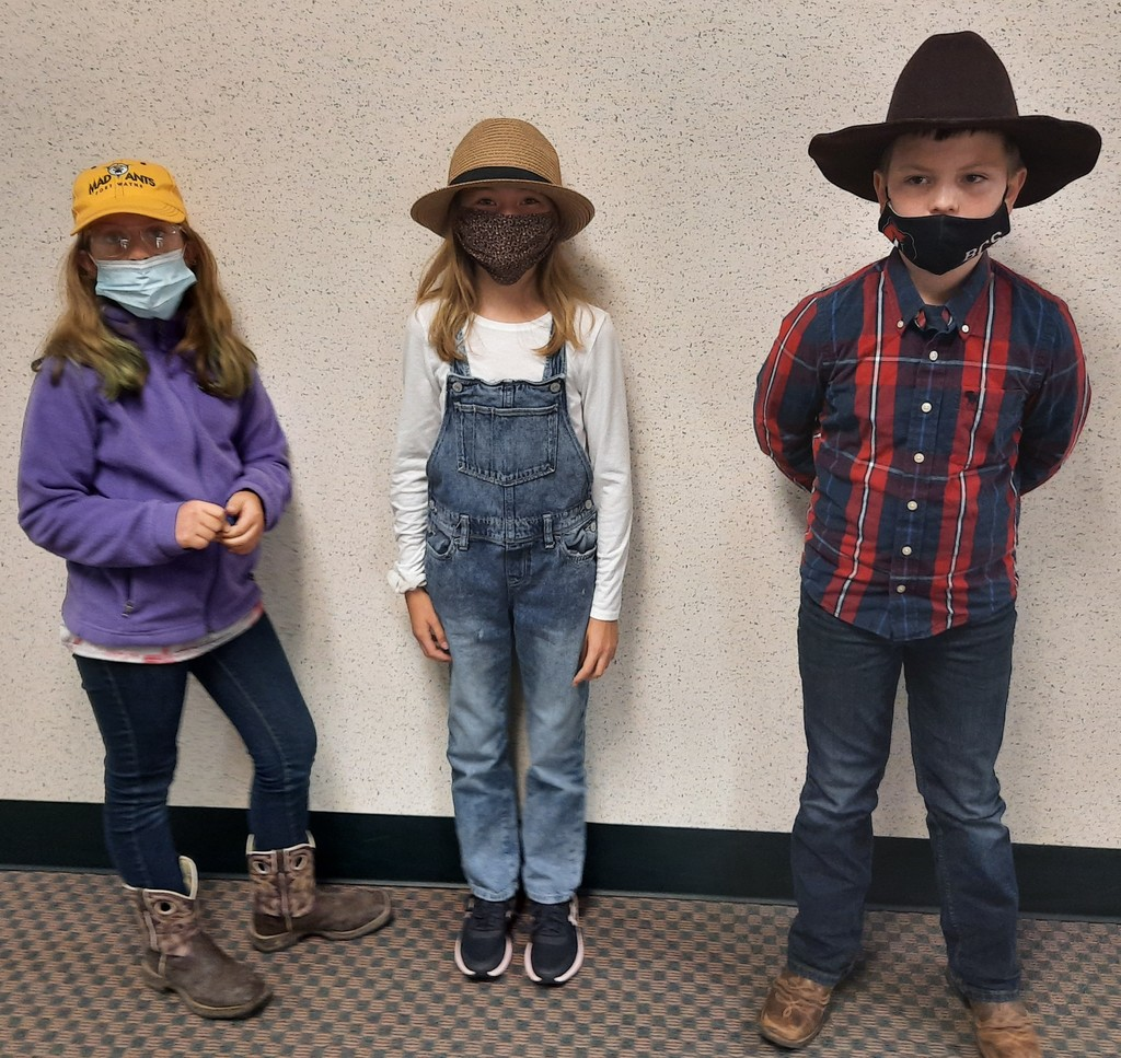 3 students dressed like farmers