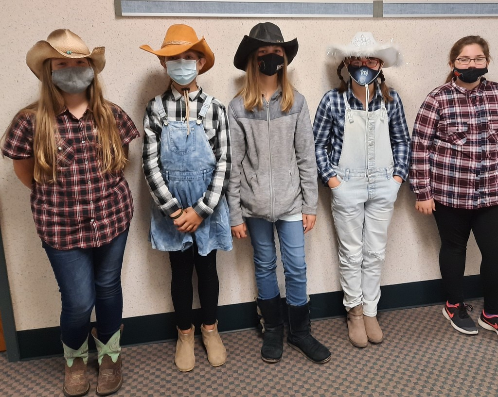 Girls dressed up like farmers