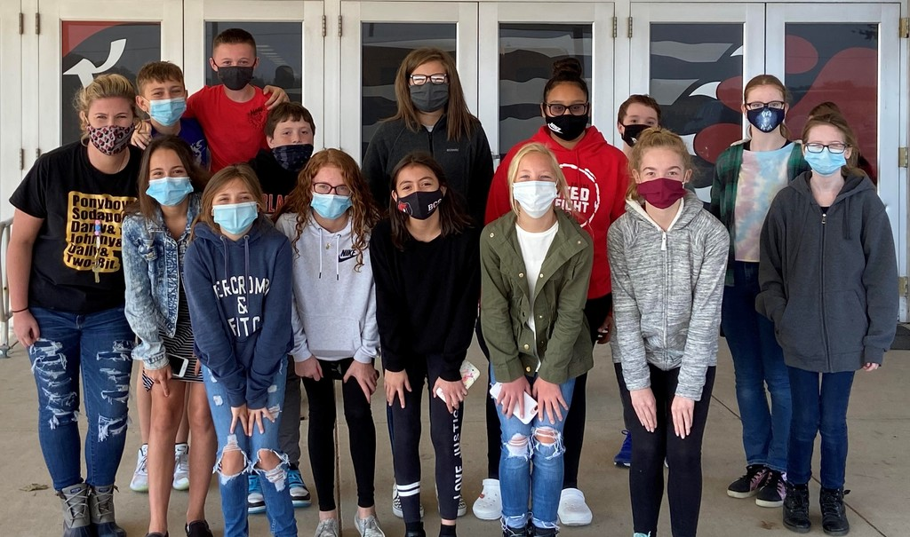 Group of masked 7th grade boys and girls