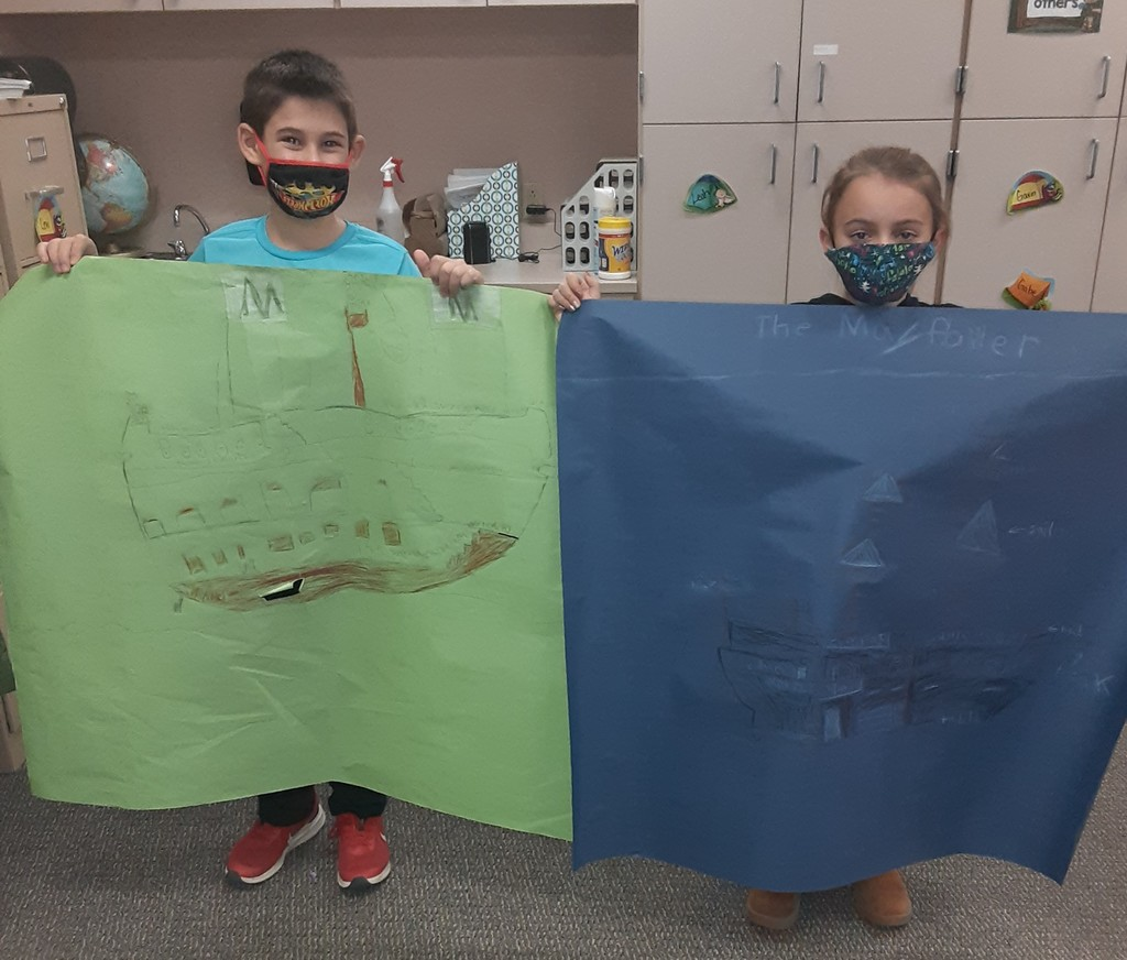 two boys share their Thanksgiving poster