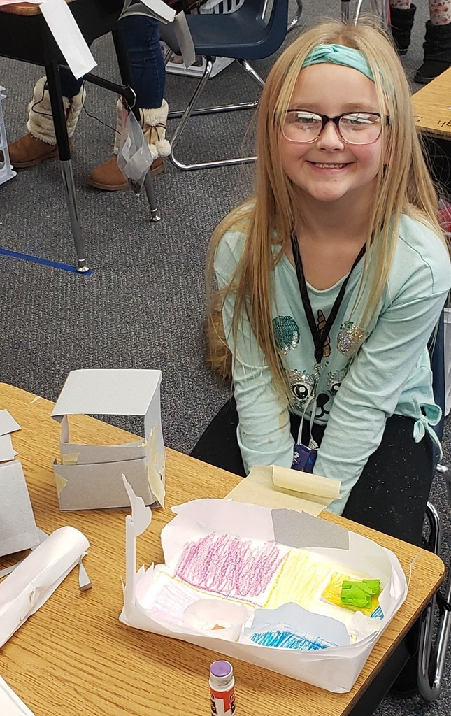 Smiling girl with eraser house
