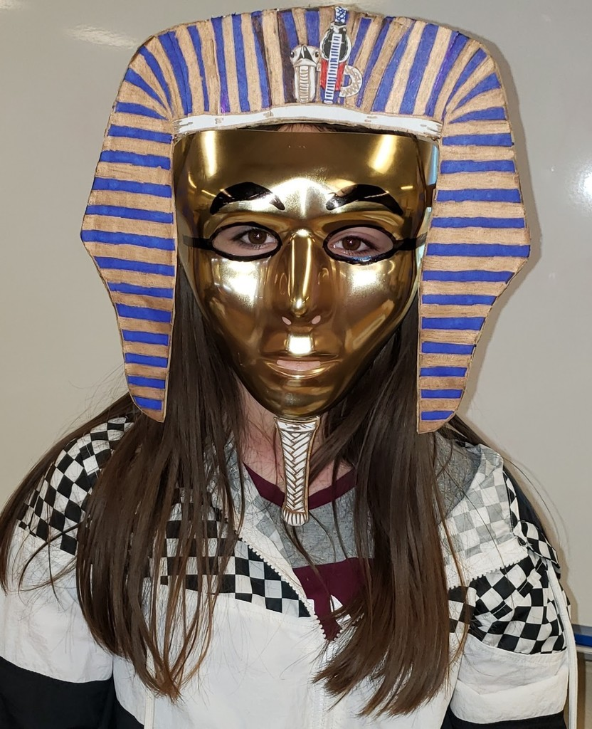 Girl dressed up in Egyptian mask project