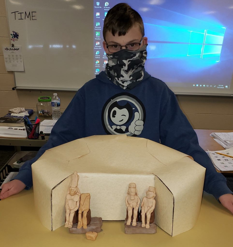 Boy holding his Egyptian project