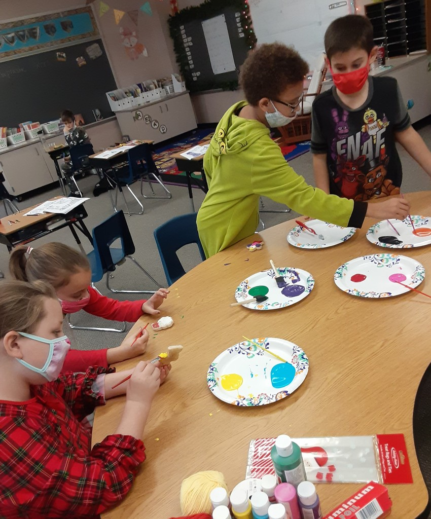 Students painting Christmas ornaments