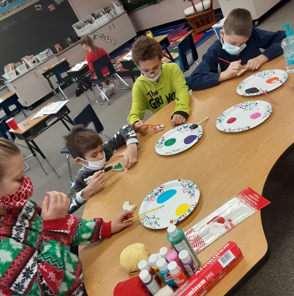 Students decorating homemade Christmas ornaments