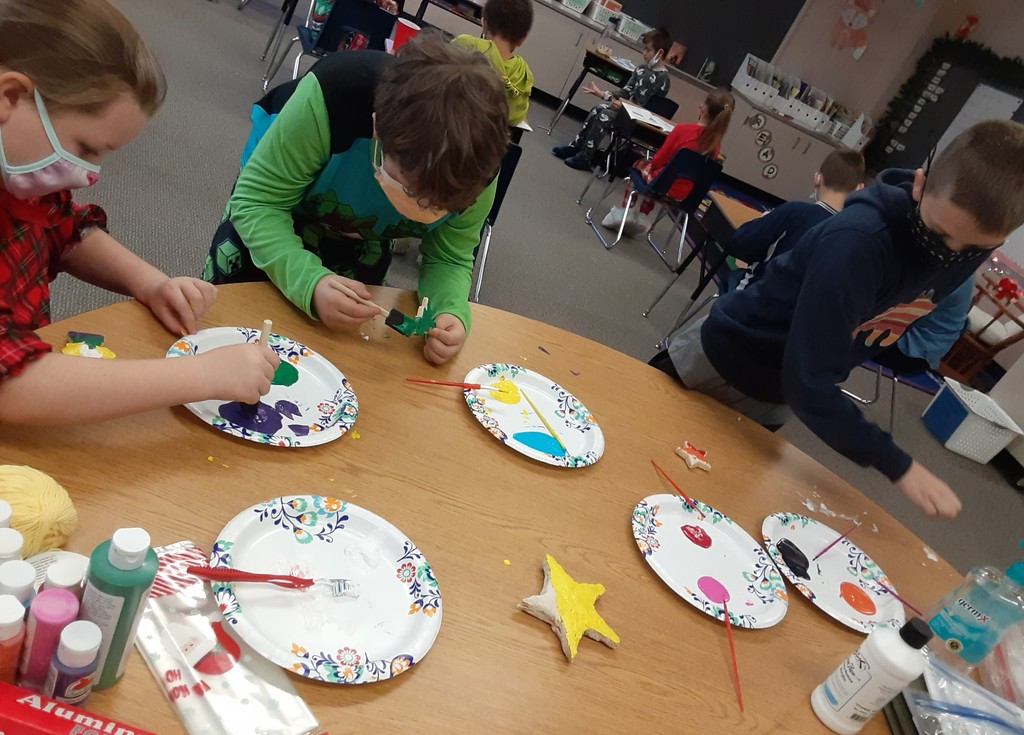 Students paint and decorate Christmas ornaments