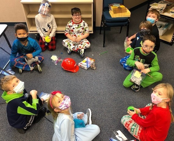 Students sitting in a circle dressed for Christmas