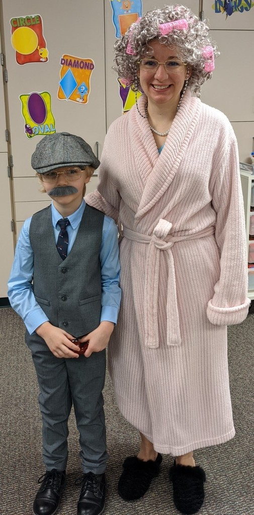 boy dressed up as old man and girl dressed up as old woman