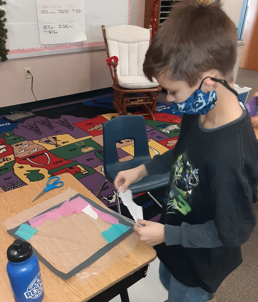 Boy working on making a hexagon.