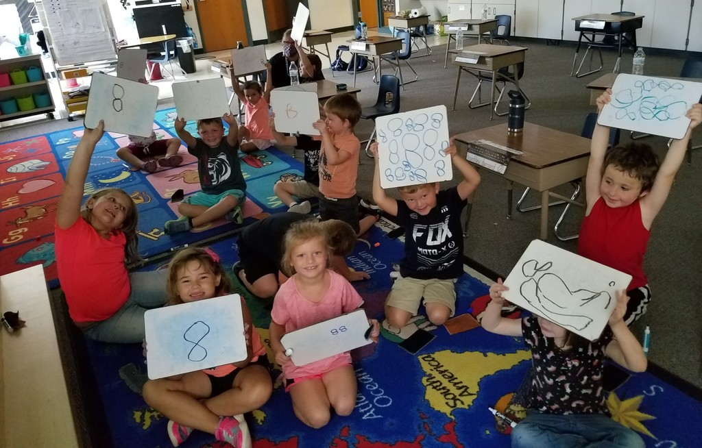 Kindergarten students working on the number 8
