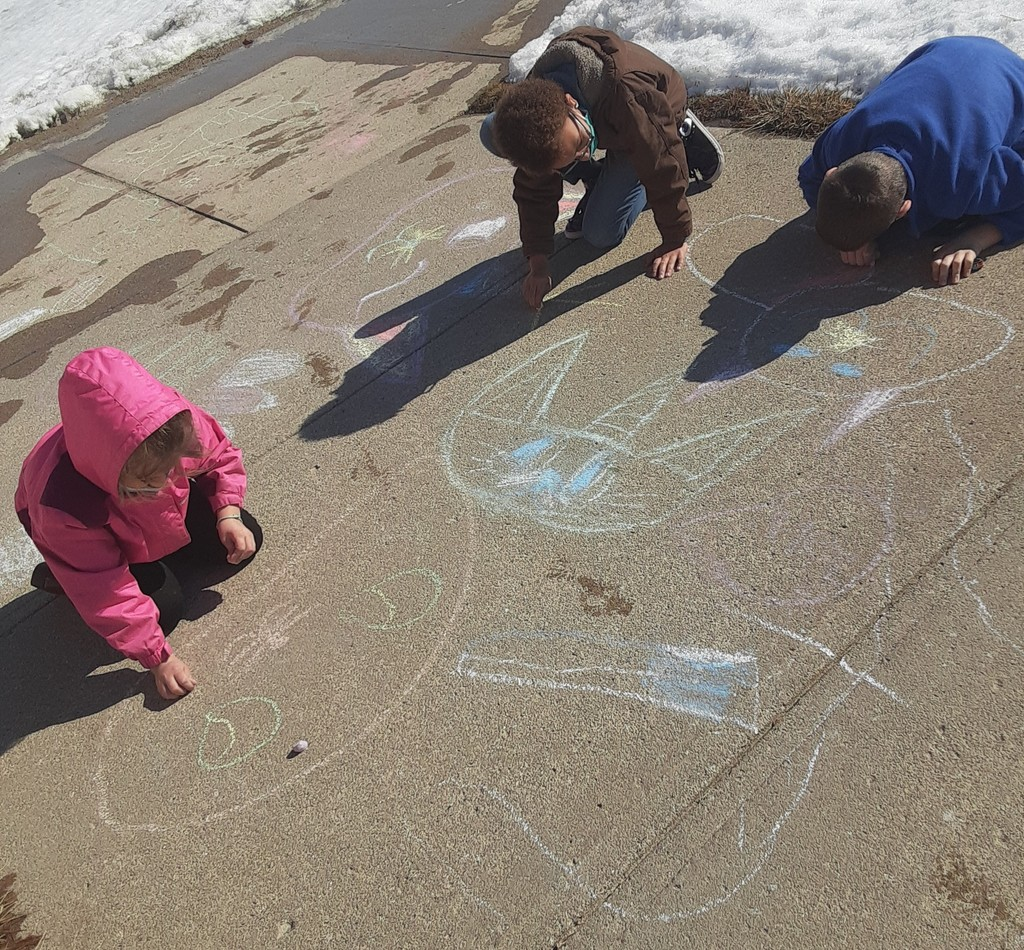 Students working on chalk drawings