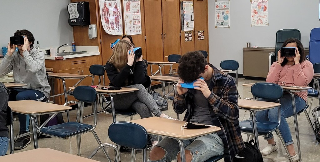 Students using VR goggles in medical class