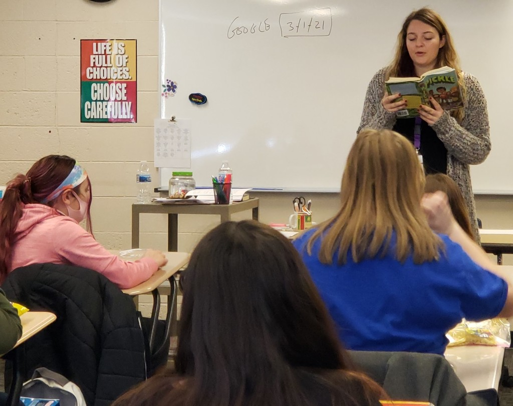 Student teacher reads to the class