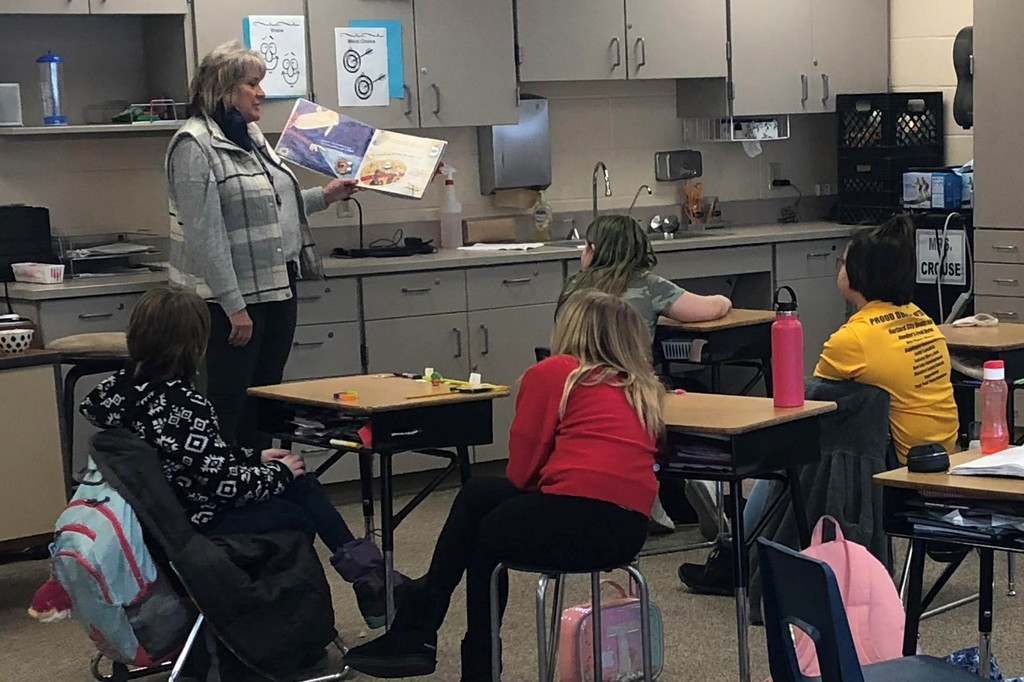 Lynn Bauer reads a book to the class