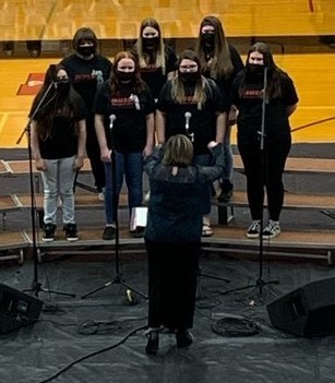 Choir members perform during concert