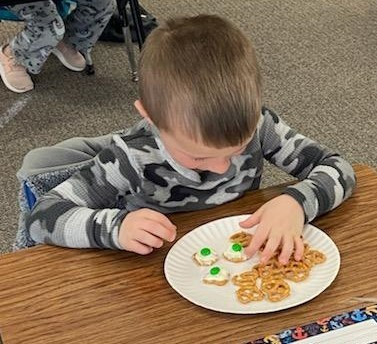 Boy concentrates on his green eggs and ham snack