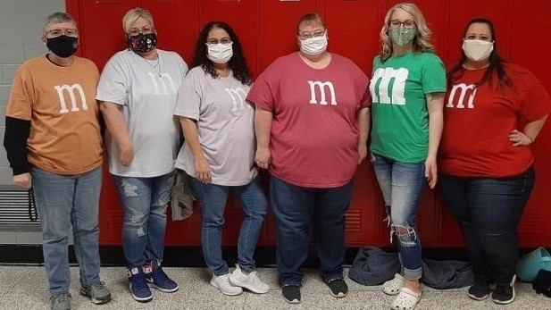 Special Ed staff dress up like M&Ms