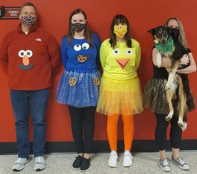 Guidance staff dresses like Sesame Street characters