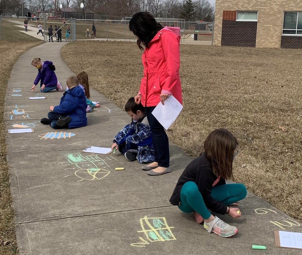 Northside students use sidewalk to work on math problems