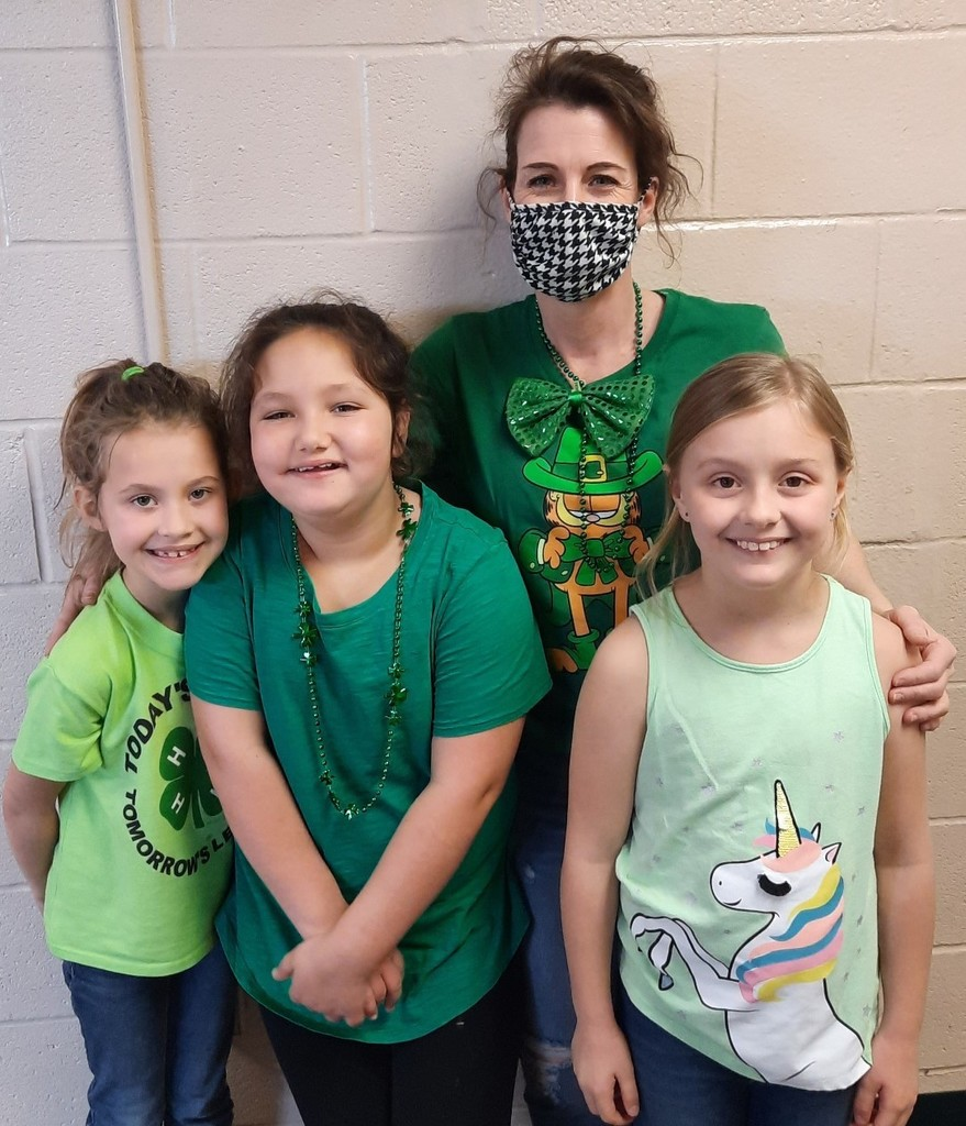 Meg Ellison and 3 girls decked out in St. Pat green