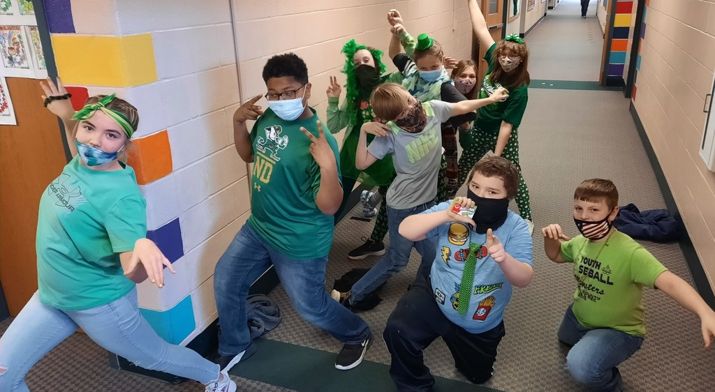 Group of students acting goofy in the hallway