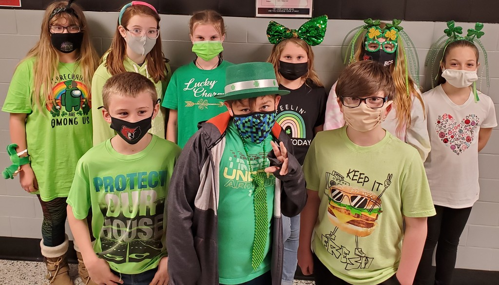 Group of kids dressed up for St. Patrick's Day