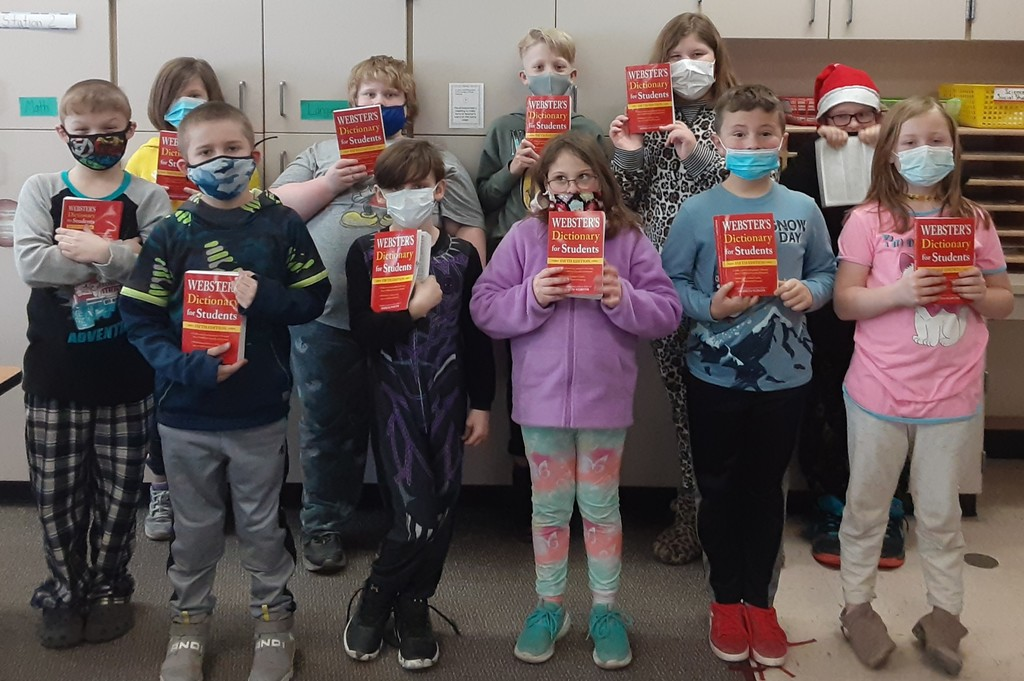 Second group of 3rd grade students displaying their dictionaries