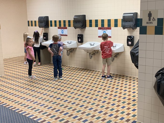Kindergarten students washing their hands