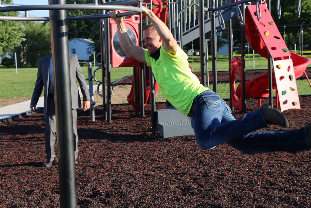 Chris Smith plays on playground equipment