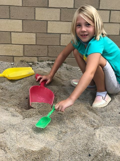 2nd grade girl playing in sand