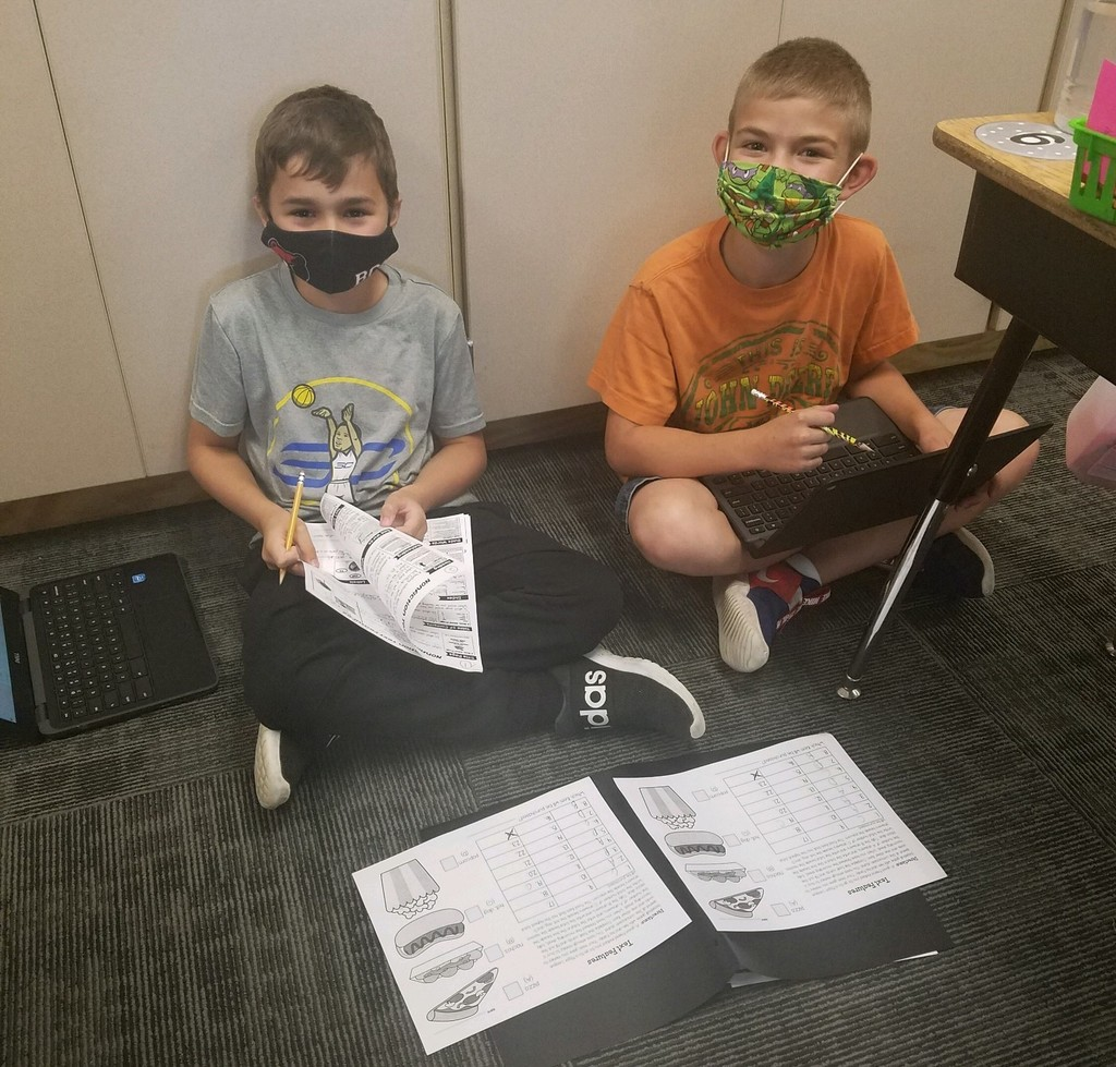 Two boys working on an assignment