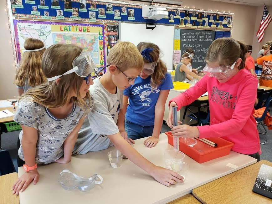 Students exploring in science class